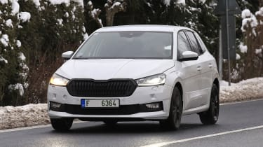 Skoda Fabia in camouflage driving - front