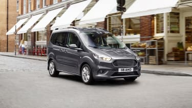 Ford Tourneo Courier driving in town