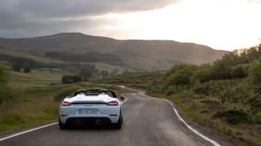 Porsche 718 Boxster Spyder parked on mountain road
