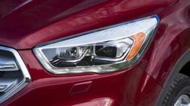Sharp-looking, angular headlights are typically Ford