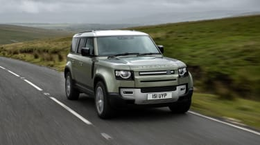 2020 Land Rover Defender 110 P400e plug-in hybrid - front 3/4 view on road