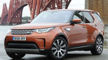 Land Rover Discovery  parked next to bridge