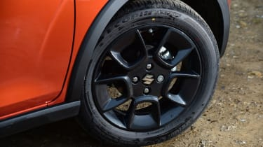 Black extended wheelarches and chunky alloy wheels add to its SUV-style swagger