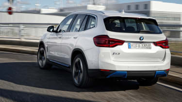 BMW iX3 SUV rear 3/4 tracking
