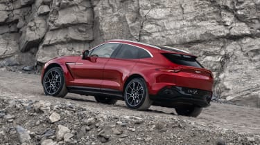 Aston Martin DBX parked on a hill - rear side view