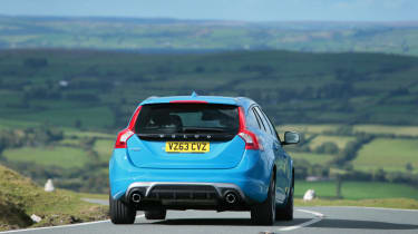 The V60 has artificially heavy steering and firm suspension but still leans heavily in corners