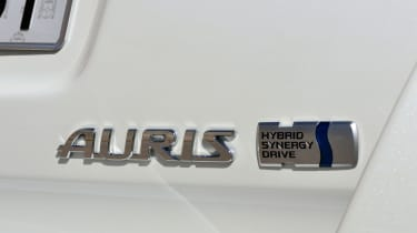 Depending on wheel sizes, the hybrid version does around 75mpg and emits around 85g/km CO2