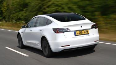 Tesla Model 3 - rear 3/4 view driving