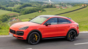 Porsche Cayenne Coupe SUV side driving
