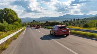 2020 Skoda Octavia Estates driving in camouflage - rear view
