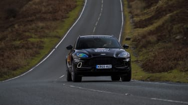 Aston Martin DBX prototype driving on Welsh road