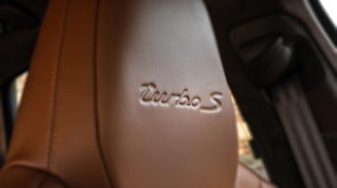 Porsche Cayenne Turbo S E-Hybrid turbo logo on seat