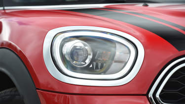 Circular LED-daytime running lights and chrome headlight surrounds help give the MINI its character