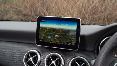 We're not fans of the 'perched' infotainment screen, but the controls are logically laid out