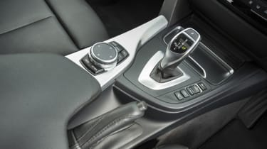 It's controlled via a wheel on the centre console, which is safer than using a touchscreen once on the move