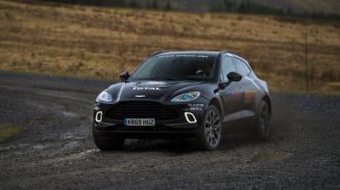 Aston Martin DBX prototype cornering on a gravelly track