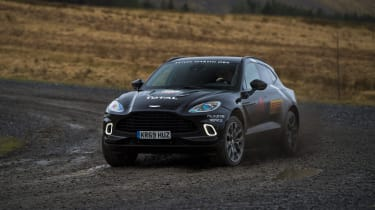 Aston Martin DBX prototype cornering on a gravelly track