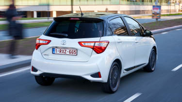 Toyota Yaris driving in city - rear view