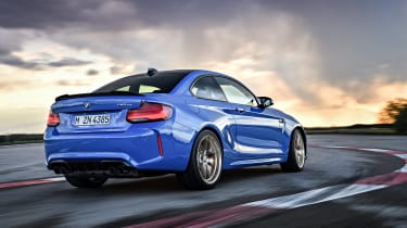 BMW M2 CS driving on racetrack - rear