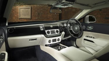 When it isn't in use, the infotainment system is hidden behind wooden trim matching the dashboard