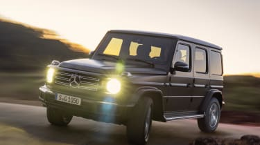 Mercedes G-Class driving with headlights on