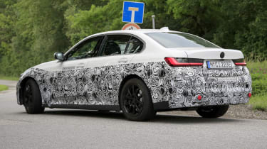 Electric BMW 3 Series driving - rear side view