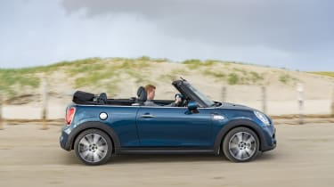 MINI Sidewalk Convertible driving on beach with roof down - side view