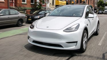 Tesla Model Y SUV front 3/4 tracking