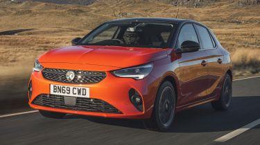Orange Vauxhall Corsa driving