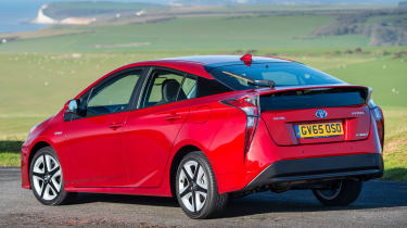 The Prius plug-in hybrid has a 30-mile all-electric range. A full charge takes up to three hours