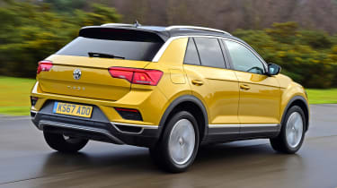 Volkswagen T-Roc SUV rear 3/4 tracking yellow