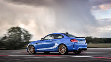BMW M2 CS driving - side view