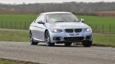 BMW 3 Series Coupe -  front 3/4 driving