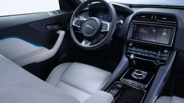 The interior cocoons the driver for a sporty feel