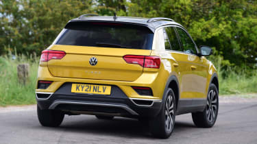 Gold VW T-Roc driving - rear