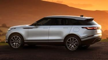2021 Range Rover Velar P400e plug-in hybrid at sunset - side/rear view