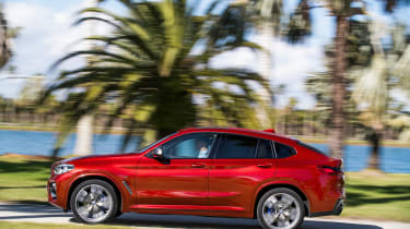 BMW X4 tracking shot, left side