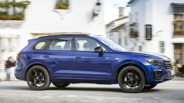 Volkswagen Touareg R driving through town - side view
