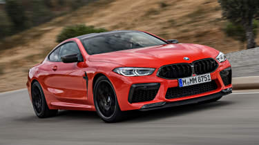 BMW M8 Competition coupe front 3/4 tracking