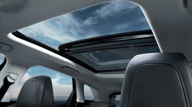 A panoramic roof floods the interior with light