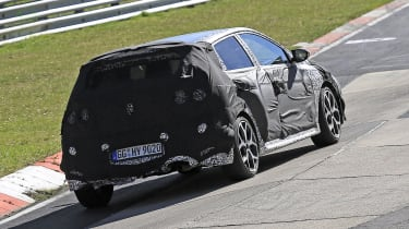 Hyundai i20 N development car - rear 3/4 view passing