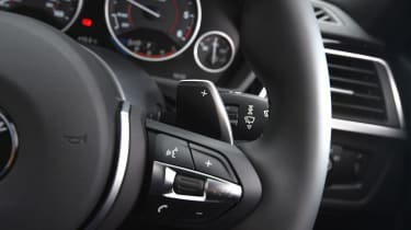 All cars get a three-spoke leather-trimmed multifunction steering wheel as standard