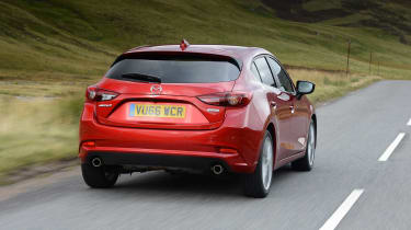 On a twisty road the Mazda3 almost has the measure of the Ford Focus