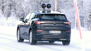 Volkswagen ID.4 prototype driving - rear view