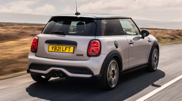 2021 MINI hatchback driving - rear view