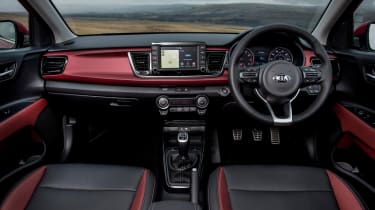 A seven-inch infotainment system and sporty steering wheel are two highlights which lift the interior
