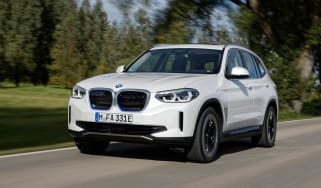 BMW iX3 SUV front 3/4 tracking