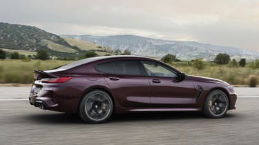 BMW M8 Gran Coupe driving - side view