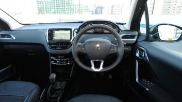 The dashboard is clean and classy looking, and soft-touch materials are used