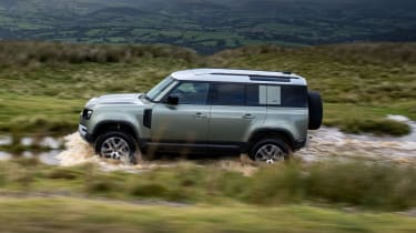 2020 Land Rover Defender 110 P400e plug-in hybrid - side view off-roading